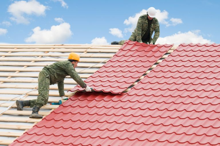 Roofing work with metal tiles